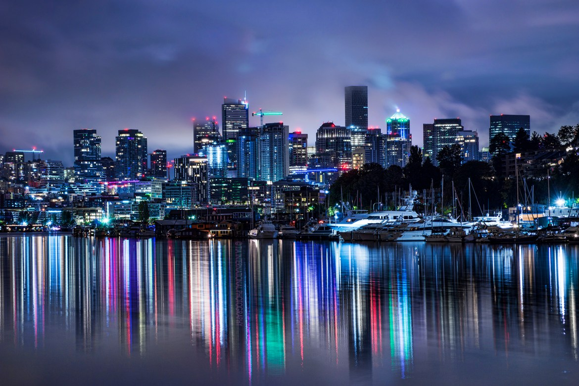 Early morning moodiness and reflections of the Seattle skyline on Lake Union with fog hovering above the skyscrapers / Fremont, Seattle / September 2020
