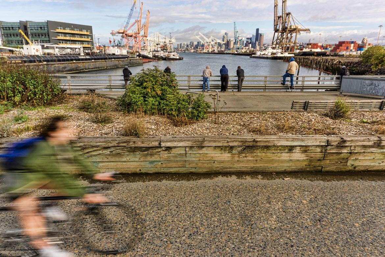 Fishermen along the guardrail of Spokane Street Bridge, Harbor Island, Seattle. (September 2020)