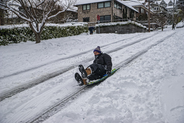 Sledding down McGraw Street, Magnolia, Seattle (February 13, 2021).