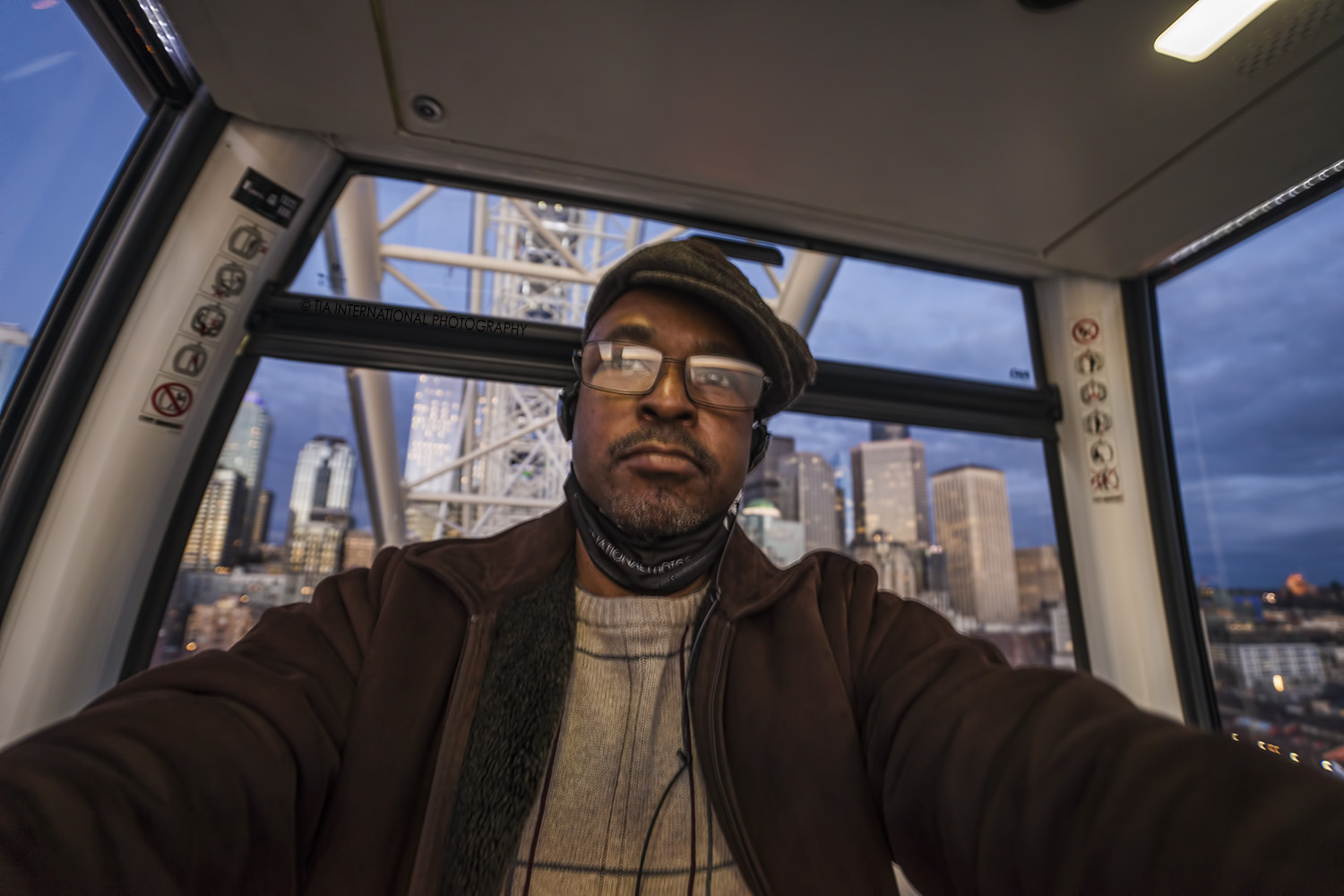 The photographer inside the gondola at the Seattle Great Wheel.