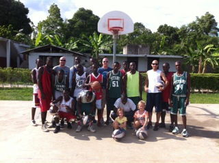 Aubry with his basketball team in Haiti.