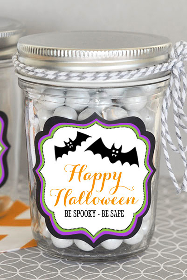 Mason jar for party favors with personalized sticker label