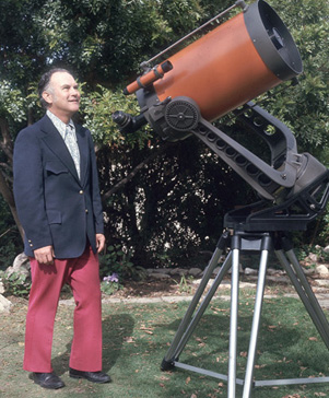 Telescope visionary Tom Johnson poses with one of his early Celestron Schmidt-Cassegrain telescopes.