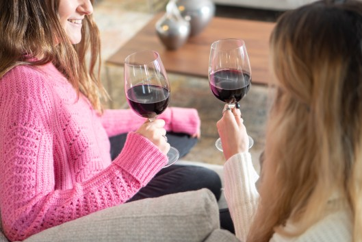 galentine's day holding red wine