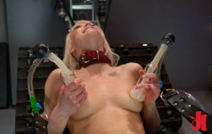 Submissive blonde gets her breasts vacuumed by a fucking machine while tied down