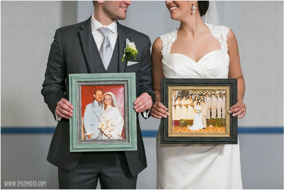 Bride & Groom holding their parents wedding pictures  •  tPoz Photography  •   www.tpozphoto.com