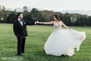 Bride and Groom twirling at their Baltimore Greek Wedding
