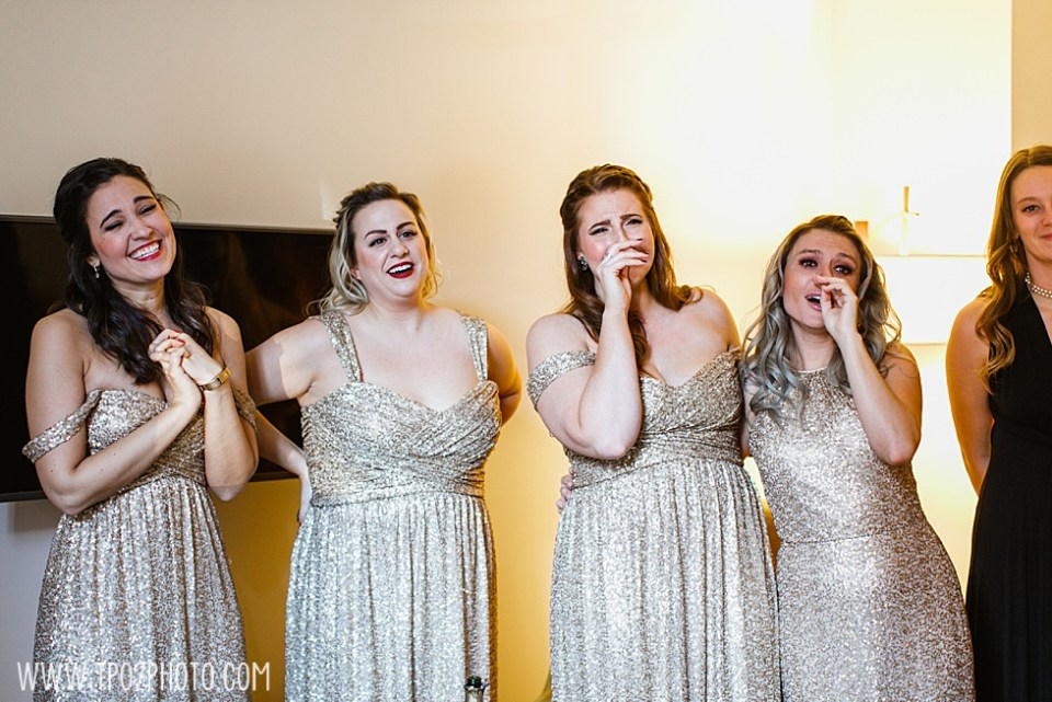Bridesmaids react to seeing the bride