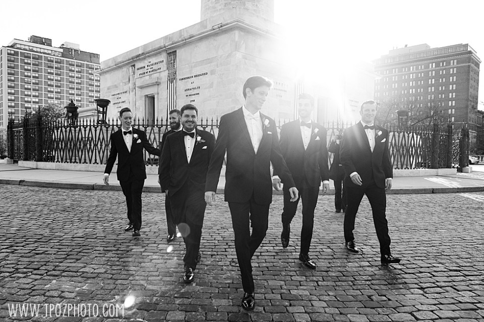 Groomsmen walking in Baltimore cobblestone street