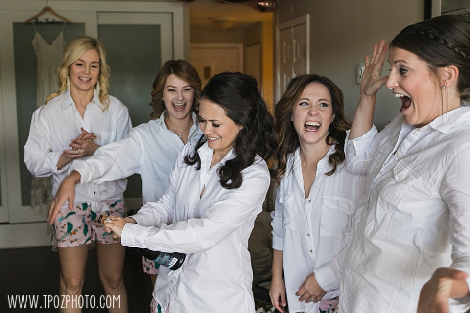 bridesmaids popping champagne at St Michaels Harbor Inn