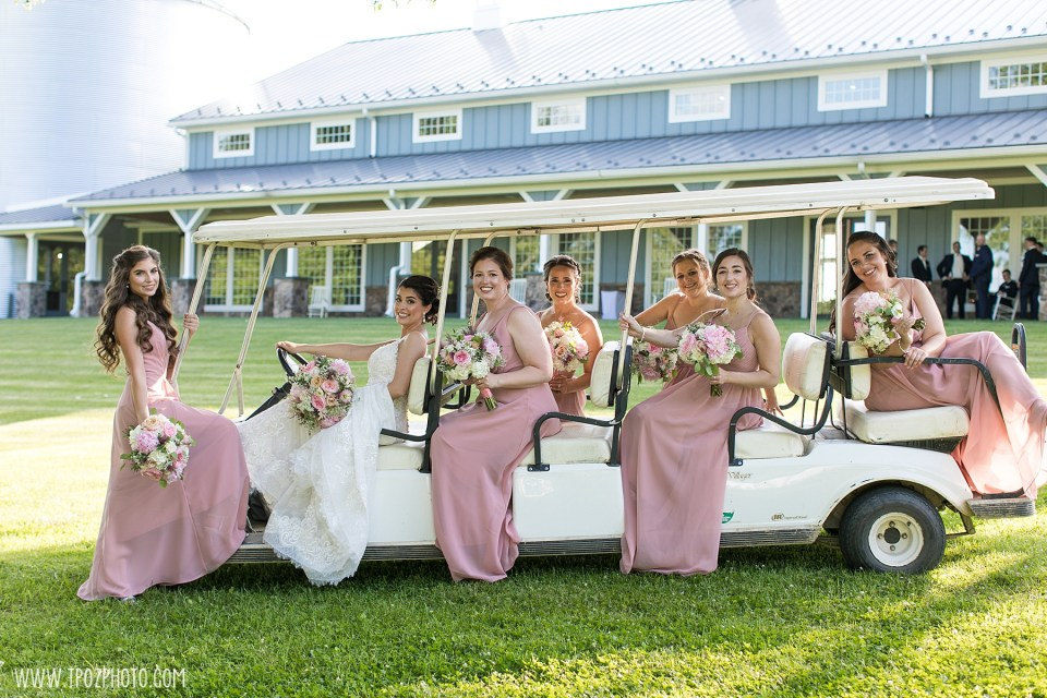 Bridesmaids on a golf cart in pink dresses at Rosewood Farms  - Maryland Wedding Photographer
