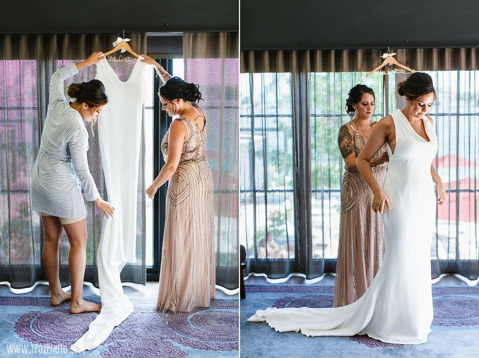 putting wedding dress on at Sagamore Pendry Hotel