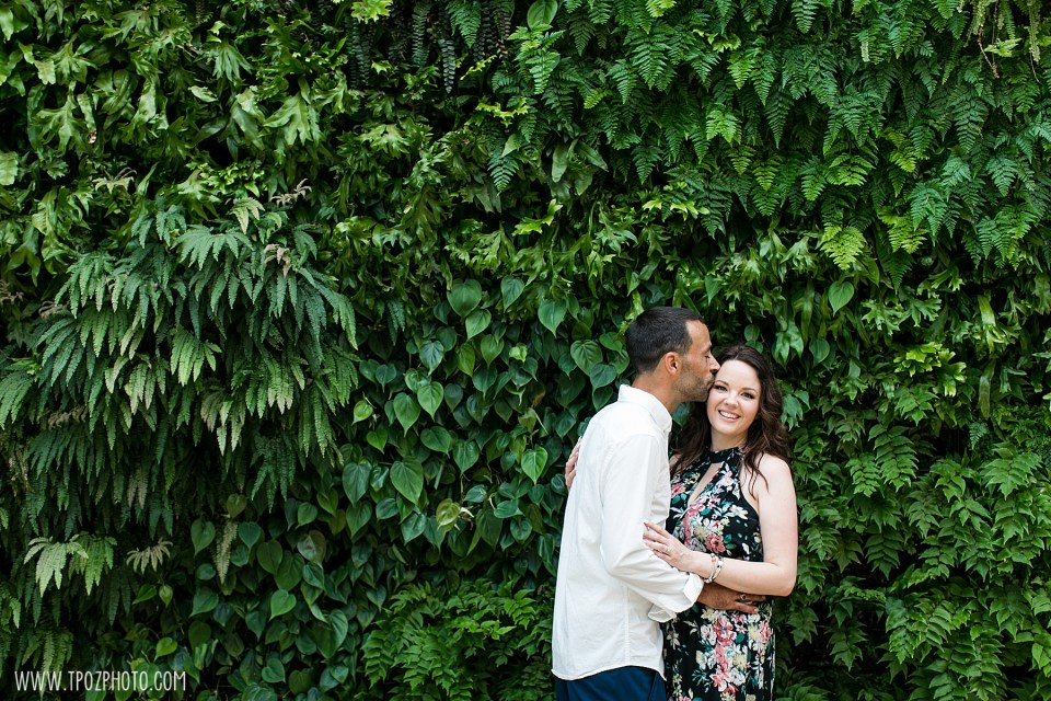 A couple in front of the Ivy wall at Longwood Gardens