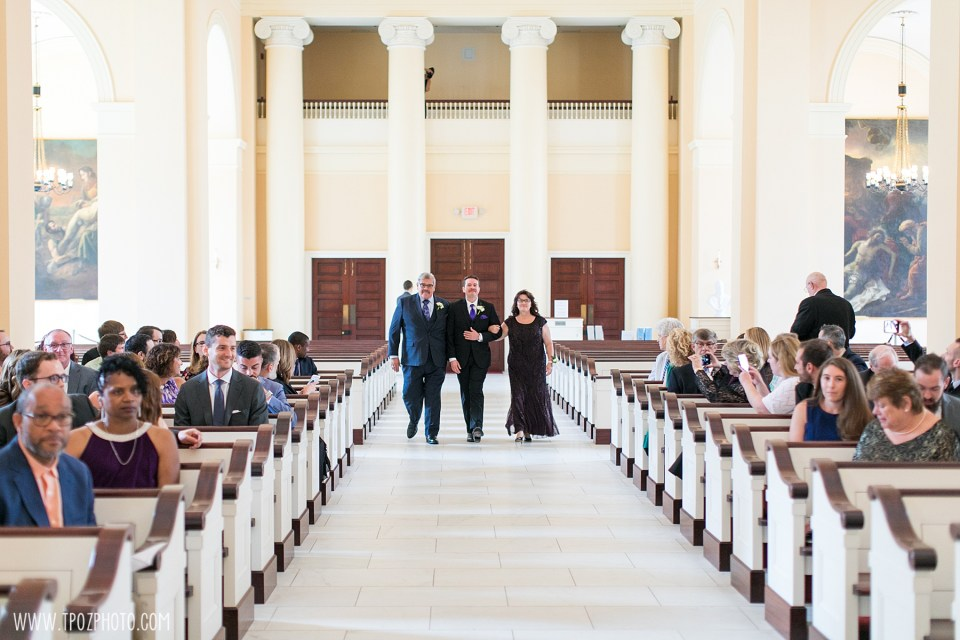 Groom walks parents down the aisle at a Baltimore Basilica Wedding Ceremony