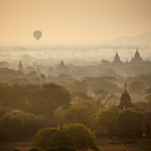 Balloons and mist rising over Bagan