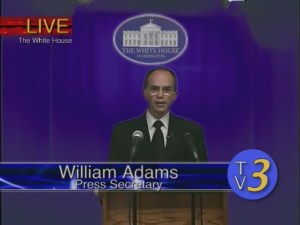 Scott Forbes as Press Secretary Adams