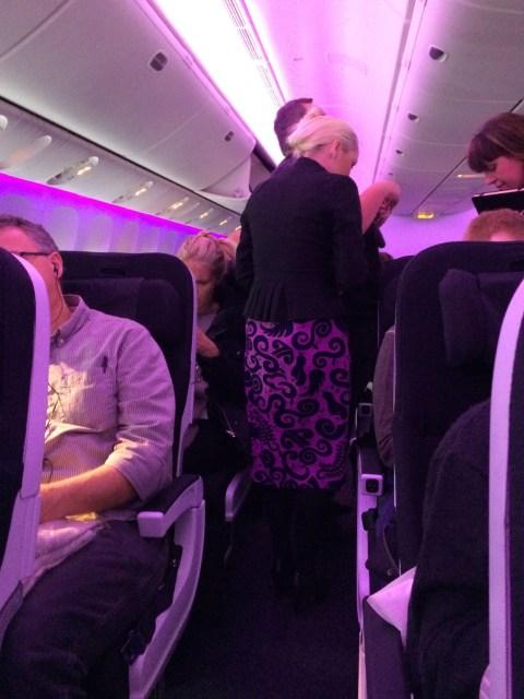 Purple Flight Attendants on Air New Zealand Flight NZ2