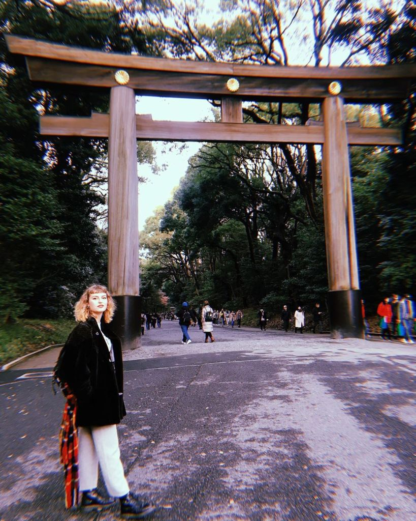 Girl posing in front of Torii Gate Harajuku