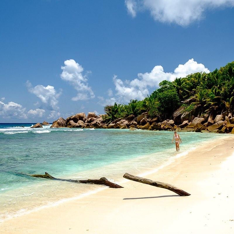 Strolling by Anse Coco Beach