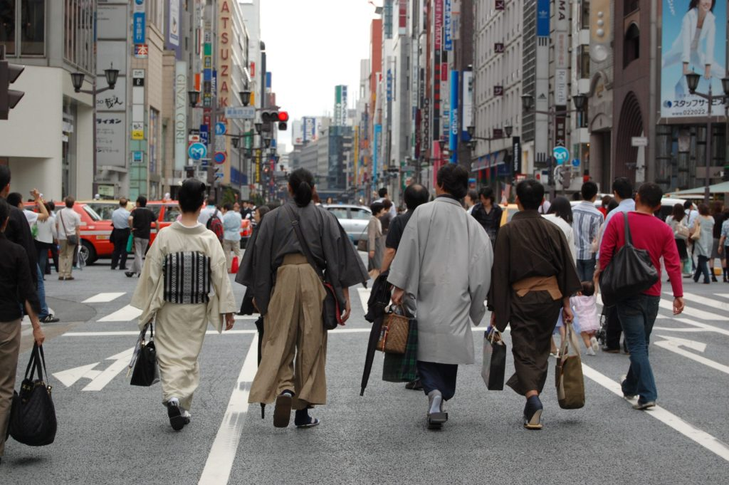 Locals dressed in traditional clothing roaming Ginza Japan