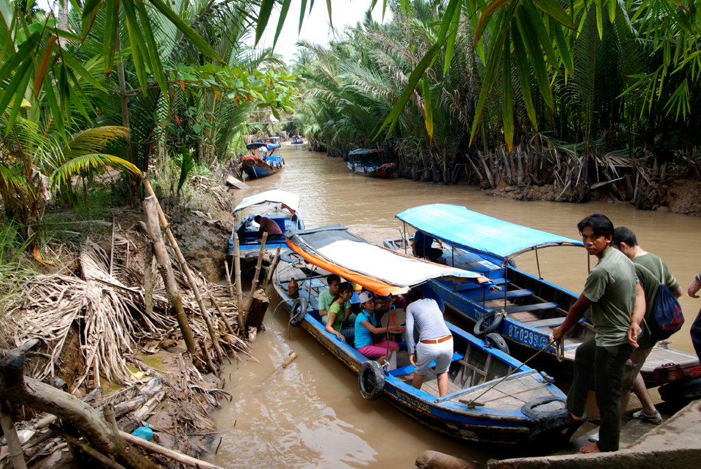 Take a tour to Mekong Delta and find riverside villages and colourful floating markets