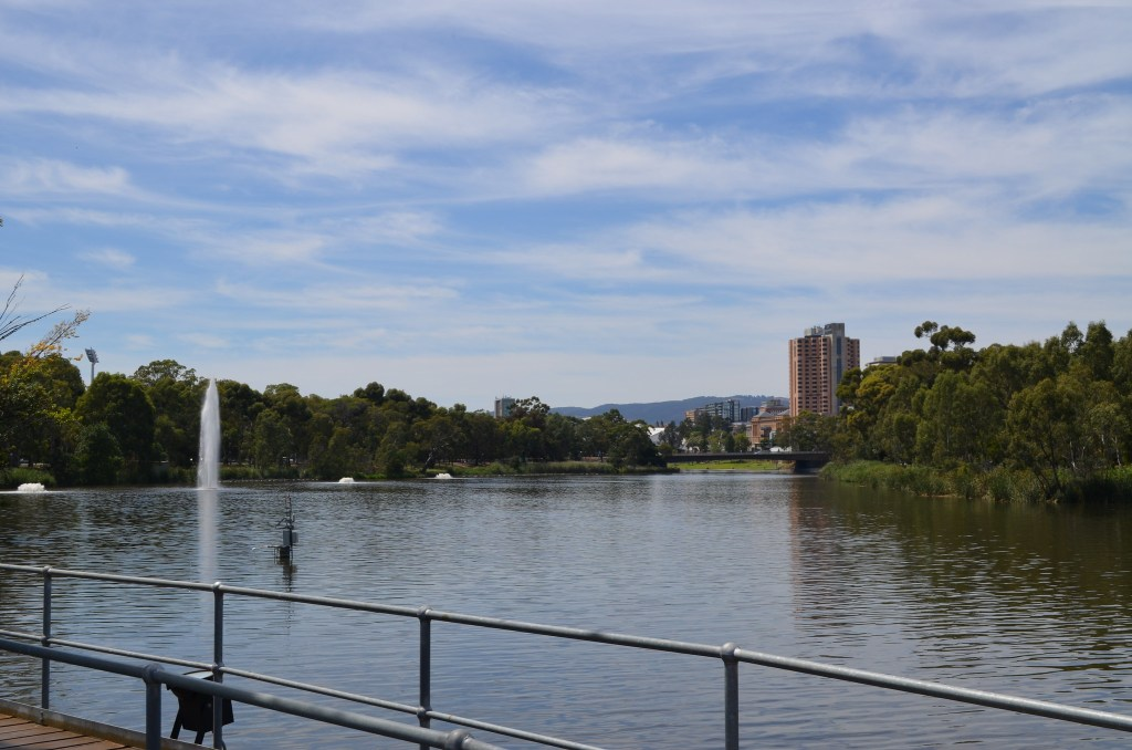 Looking to city from weir on Torrens River at west end of city, Adelaide