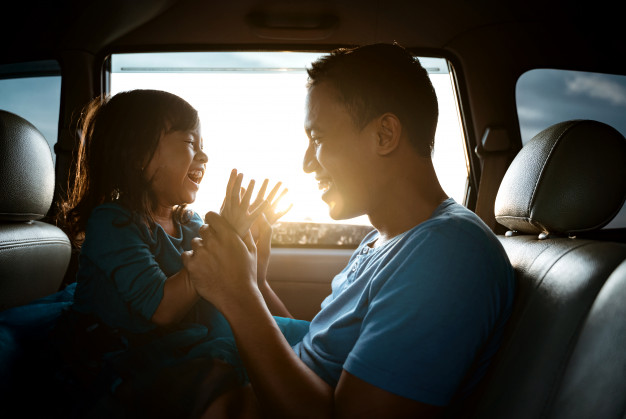 asian-daughter-with-father-car-playing_8595-50