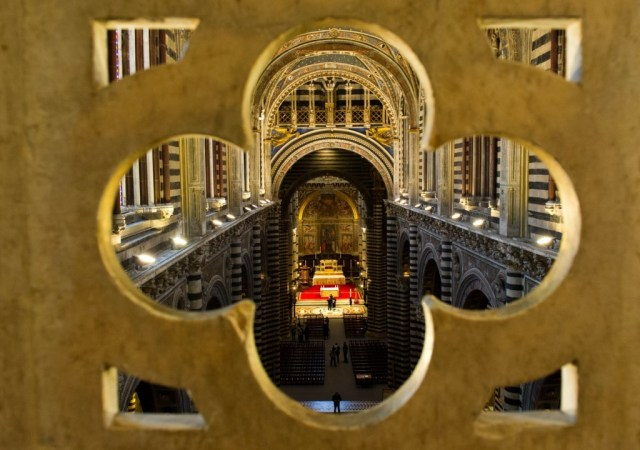 "SIENA, ITALY - APRIL 05:  A view of the nave from the balcony under the roof  seen during the press preview of ""La Porta del Cielo"" at Duomo on April 5, 2013 in Siena, Italy. The newly launched ""Door to Heaven"" from April 6th will allow visitors to enjoy a spectacular new view of the Duomo and the city of Siena.  (Photo by Marco Secchi/Getty Images)"