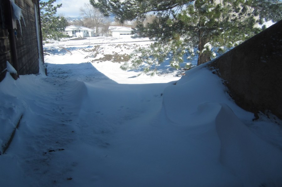 Snow drifted on the north and west