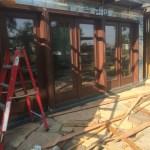 Siding torn off patio doors