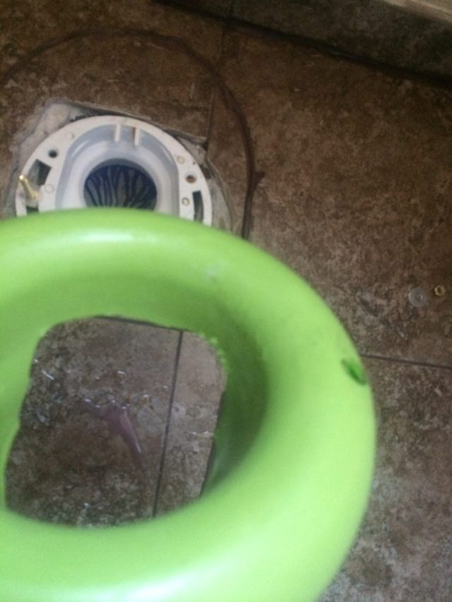 Cut opening in toilet ring flange