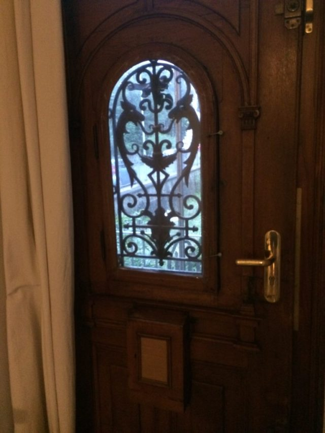 Ornate oak door with wrought iron inset