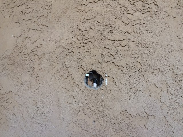 Hole in stucco wall