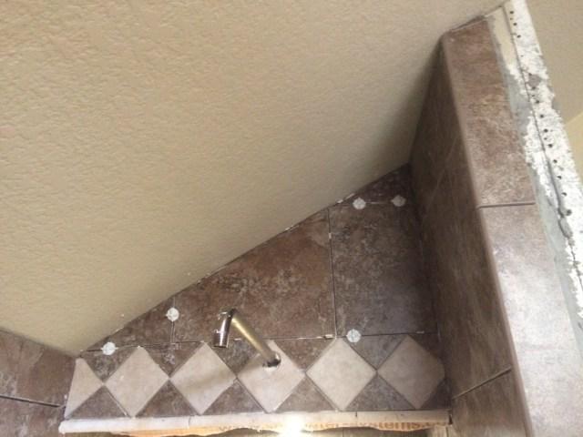 Shower head wall tiled