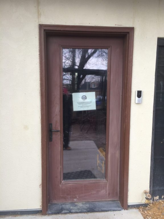 Front door with LEED project sign
