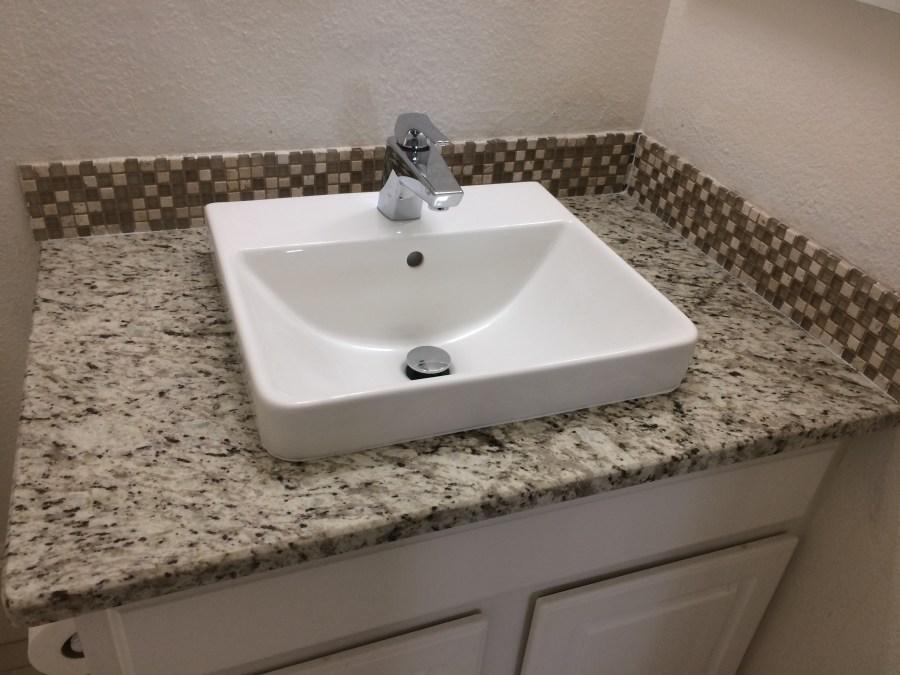 Basement bath granite, sink and faucet