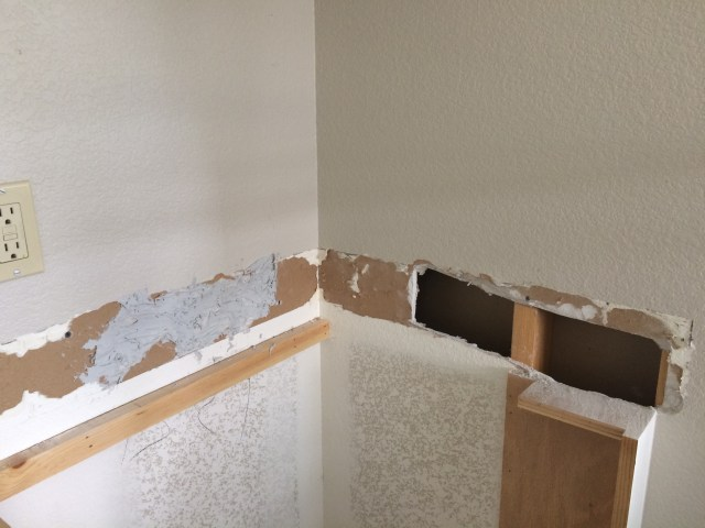 Broken drywall cut out