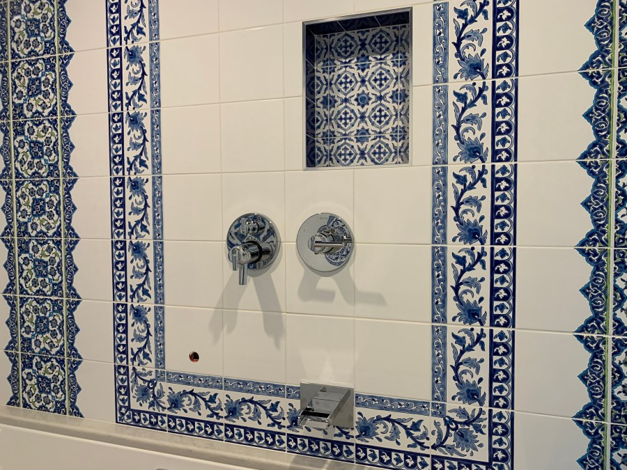 Tile design on controls wall in steam room