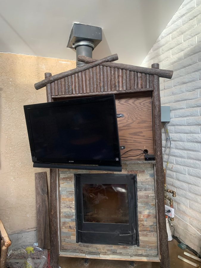 TV tilted and pulled out for viewing