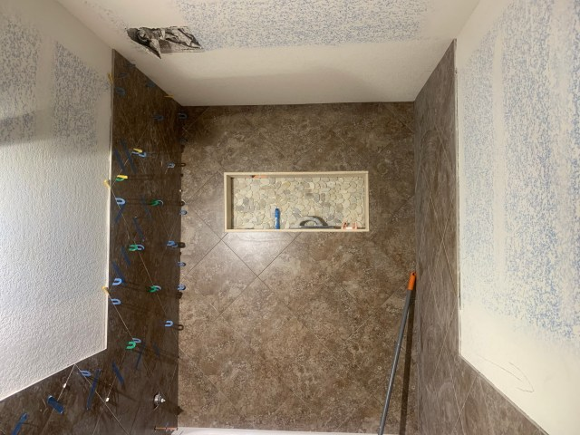 Field tile installed with niche