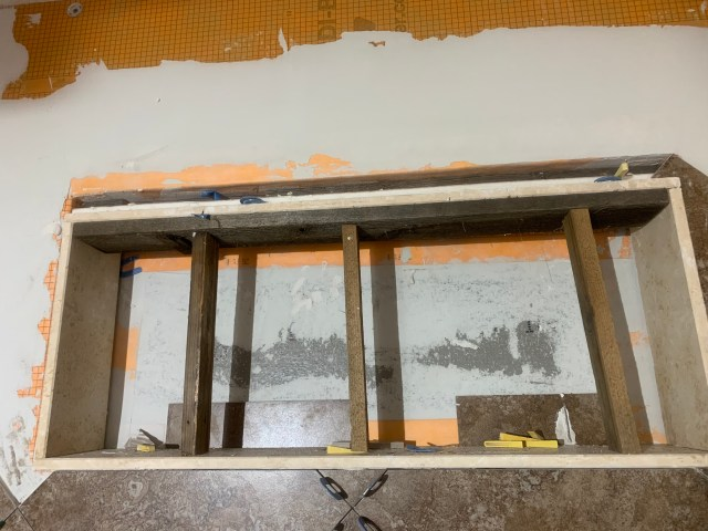 Top marble installed with gap for electrical box depth