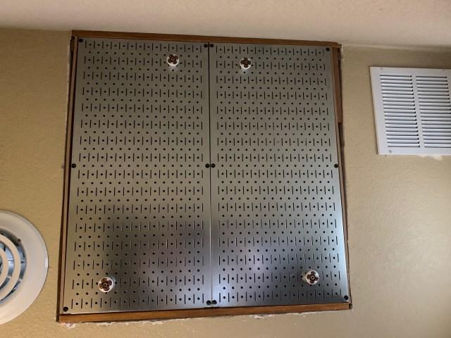 Pegboard panel door to attic