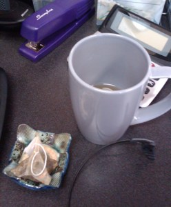 A tea-sachet holder from Richard, in use on Kelly's desk