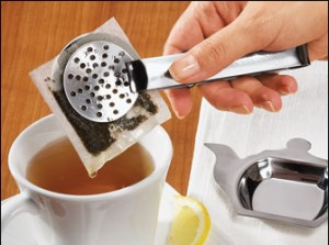 Squeezing tea sachets is a dream come true for kitchen gadget lovers. We're posting some photos of squeezers we found online.