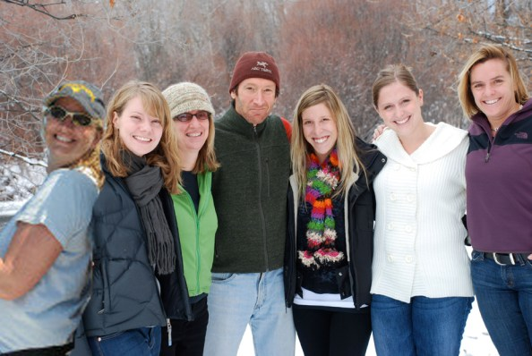 It snowed in the Roaring Fork Valley this morning,  so we tromped outside and stood by the Roaring Fork River, just behind our office, to take this snowy, holiday photo. From left, Jen (who now lives in New Jersey), Naomi, Gigi, Richard, Lindsay, Kelly and Bess.