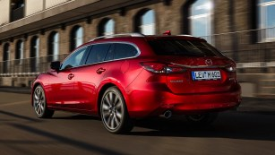 2018 Mazda 6 tourer soul red side rear moving 2