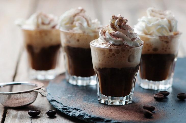 Delicious coffee with crean and cocoa
