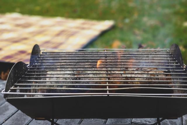 Grill lit in backyard
