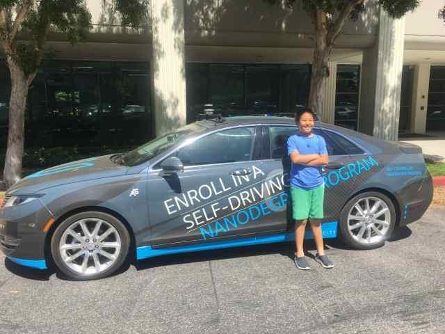 11-year-old Aaron Ma with Carla, Udacity's Self Driving Car