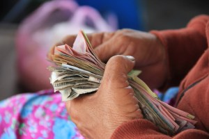 Header image of person holding banknotes